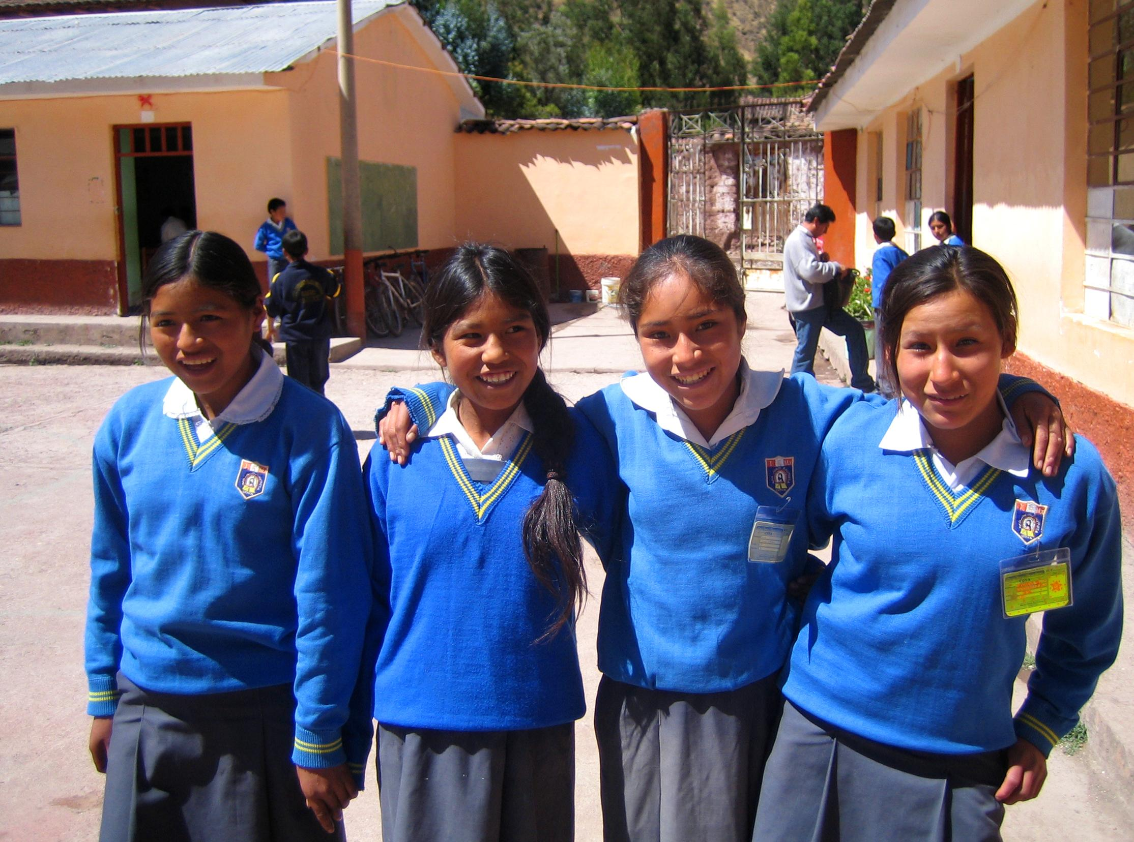 A group of girls pose for a photo outside our volunteer teaching placements in Peru